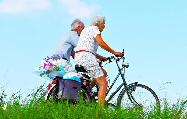 man and woman riding bikes